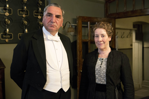 """This undated publicity photo released by Masterpiece shows Jim Carter, left, as Carson and Phyllis Logan as Mrs. Hughes, in """"Downton Abbey,"""" series 3.  The show is nominated for outstanding drama series at Sunday's 65th Primetime Emmy Awards. (AP Photo/Masterpiece, Giles Keyte/Carnival Films)"""