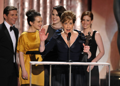 """FILE - In this Jan. 27, 2013 file photo, Phyllis Logan accepts the award for outstanding ensemble in a drama series for """"Downton Abbey"""" at the 19th Annual Screen Actors Guild Awards at the Shrine Auditorium in Los Angeles. """"We are so not expecting this,"""" Logan said, as she accepted the SAG honor. """"Shut the French windows!"""" (Photo by John Shearer/Invision/AP, File)"""