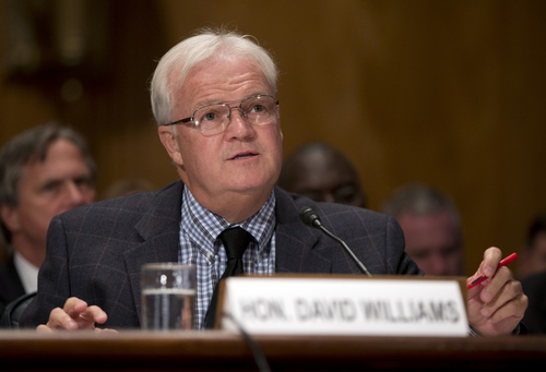 David Williams, the inspector general of the United States Postal Service speaks at the Senate Homeland Security and Governmental Affairs Committee hearing on Capitol Hill, Thursday, Sept. 19, 2013, in Washington. According to Postmaster General Patrick Donahoe, the Postal Service may need an emergency rate increase to stay afloat. (AP Photo/Carolyn Kaster)