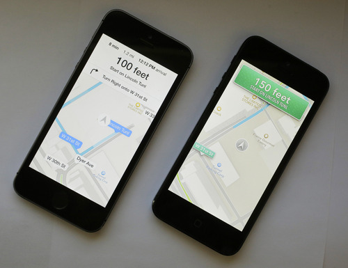 An iPhone with iOS 7 software, left, is displayed next to an iPhone with the older iOS 6 operating system, Tuesday, Sept. 17, 2013 in New York. Much of the new iOS 7 software is about cosmetic changes. In the Maps app, directions are no longer presented in green boxes that resemble highway signs, for instance. (AP Photo/Mark Lennihan)