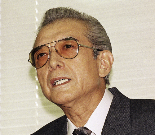 FILE - In this Friday, June 12, 1992 file photo, Hiroshi Yamauchi, then-president of Japan's Nintendo Co., answers questions during a news conference after he won the final approval to buy the Seattle Mariners at the company's head office in Kyoto, western Japan. Yamauchi, who ran Nintendo for more than 50 years and led the company's transition from traditional playing-card maker to video game giant, has died of pneumonia, Thursday, Sept. 18, 2013. He was 85. (AP Photo/Katsumi Kasahara, File)