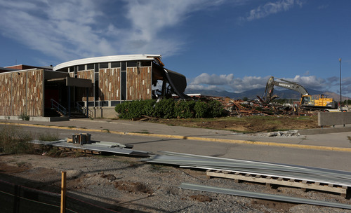 Francisco Kjolseth  |  The Salt Lake Tribune Half of the old Granger High school cafeteria, known by the students as Stonehenge in West Valley City, begins to come down as crews start the demolition process on Wednesday, Sept. 18, 2013.