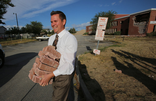 Francisco Kjolseth  |  The Salt Lake Tribune Seminary teacher Steve Miller picks out souvenirs as the old Granger High School in West Valley City begins to come down as crews start demolition on Wednesday, Sept. 18, 2013.