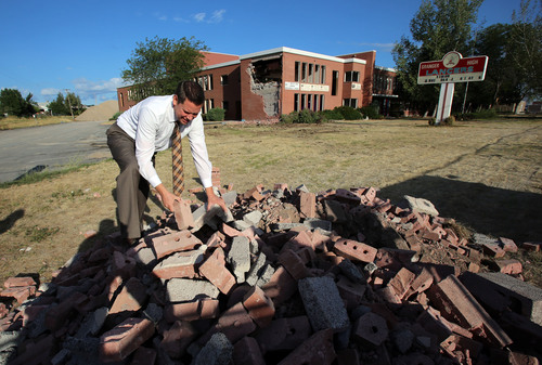 Francisco Kjolseth  |  The Salt Lake Tribune Seminary teacher Steve Miller picks out souvenirs as the old Granger High School in West Valley City begins to come down as crews start the demolition  on Wednesday, Sept. 18, 2013.