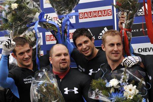 Justin Olsen, driver Steve Holcomb, Steve Mesler and Curtis Tomasevicz of the United States celebrate their victory in the four-man bobsled World Cup Sunday, Nov. 22, 2009 in Lake Placid, N.Y. (AP Photo/Lou Reuter)