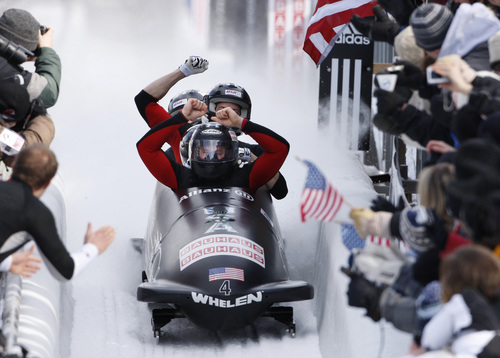American driver Steven Holcomb and teammates celebrate as they place first in the men's Bobsled World Championships in Lake Placid, N.Y. on Sunday, March 1, 2009. (AP Photo/Peter Morgan)