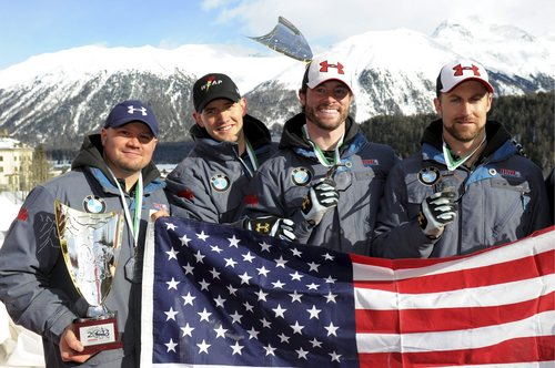 Third placed Team USA with Steve Holcomb, Justin Olson, Steven Langton and Curtis Tomasevicz, from left, celebrate on the podium for the 4-man bobsled competition at the Bob World Championships in St. Moritz, Switzerland, Sunday, Feb. 3, 2013. (AP photo/Keystone,Karl Mathis)