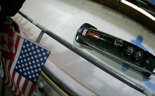 USA-2, piloted by Steven Holcomb, makes its second run in Women's Bobsled at the Turin 2006 Winter Olympic Games at Cesana Pariol, Italy, Friday, Feb. 24, 2006.  (AP Photo/David J. Phillip)