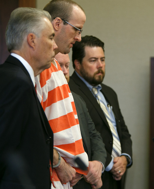 Jud Burkett  | Pool The Spectrum & Daily News As he stands with his defense team, Paul Clifford Ashton, second from left, apologizes for the murder of Brandie Jerden during his sentencing hearing in Fifth District Court Wednesday, Sep. 4, 2013 in St. George, Utah. Ashton was sentenced to life without parole for Jerden's 2010 murder and will serve the sentence concurrently with a federal sentence of life in prison for the murder of Bradley Eitner which he committed in October of 2010, two months prior to the murder of Jerden.