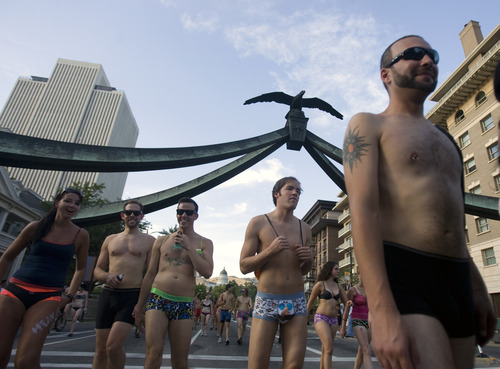Kim Raff  |  The Salt Lake Tribune People run down State Street during the 5k Utah Undie Run in Salt Lake City, Utah on September 9, 2012. Thousands of people gathered in hopes of breaking last years record of 2,270 people which was the largest gathering of people wearing only underpants.