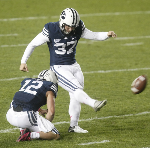 Chris Detrick  |  The Salt Lake Tribune Brigham Young Cougars kicker Justin Sorensen (37) kicks a field goal that is blocked by BYU during the first half of the game at LaVell Edwards Stadium Friday October 5, 2012. BYU is winning the game 6-3.