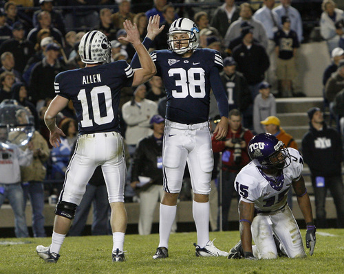 Provo, UT --11/8/07-- BYU's Matt Allen and Mitch Payne celebrate after Payne kicked a field goal to make the score 27-15 during the 4th quarter of the game at LaVell Edwards Stadium. BYU won 27-22  ------------------------------- BYU vs.TCU football  Photo by Chris Detrick/The Salt Lake Tribune frame #_2CD7883