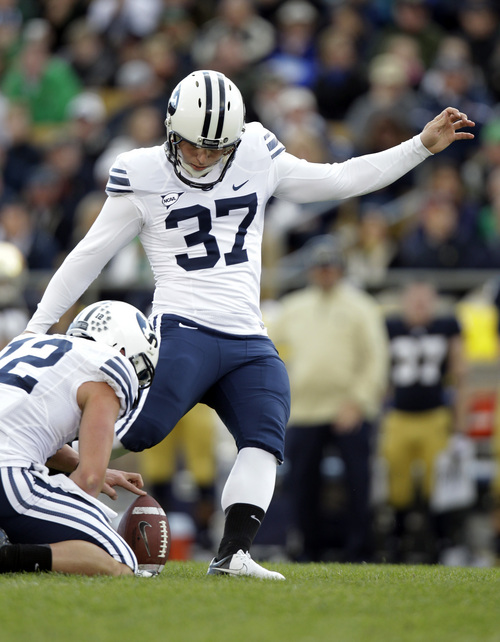 BYU kicker Justin Sorensen misses a field goal from the hold of JD Falslev during the second half of an NCAA college football game against Notre Dame in South Bend, Ind., Saturday, Oct. 20, 2012. Notre Dame defeated BYU 17-14. (AP Photo/Michael Conroy)