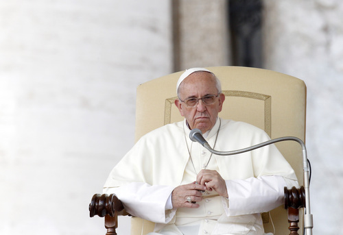 Pope Francis looks on during his weekly general audience in St. Peter's Square at the Vatican, Wednesday, Sept. 18, 2013. (AP Photo/Riccardo De Luca)