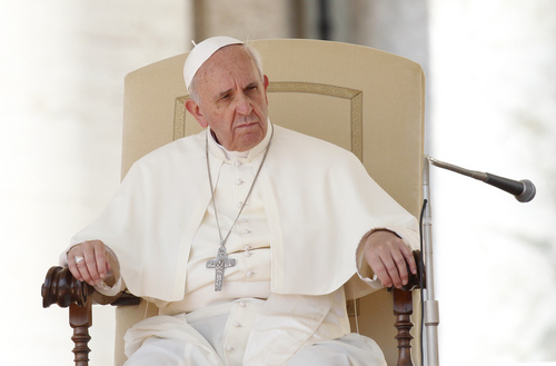 Pope Francis sits during his weekly general audience in St. Peter's Square at the Vatican, Wednesday, Sept. 18, 2013. (AP Photo/Riccardo De Luca)