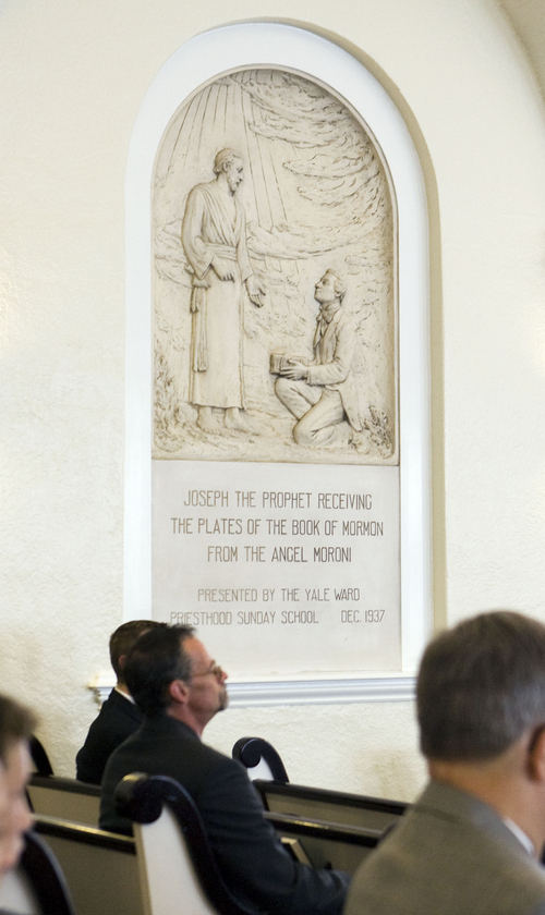 Keith Johnson | The Salt Lake Tribune  A relief of Joseph Smith receiving the plates of the Book of Mormon from the Angel Moroni decorates the chapel of the Yale Ward in Salt Lake City, September 1, 2013. The relief was made by Torleif Knaphaus in 1937. The newly remodeled Yale Ward, located at 1431 Gilmer Dr., was originally  built in 1924. The ward is having an open house on Sept. 7 to show the new