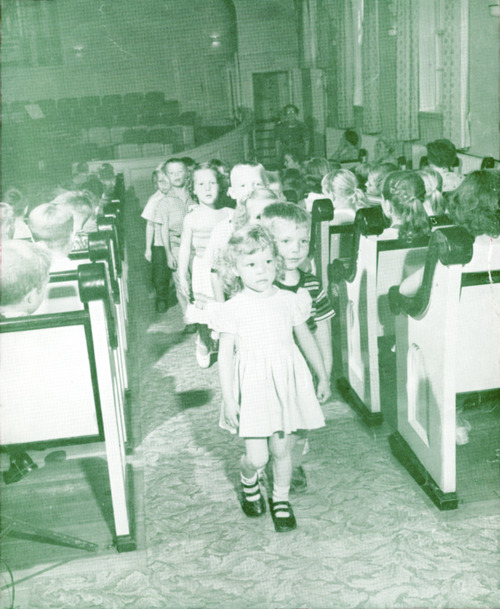 | Courtesy Primary children leaving the Yale Ward chapel in 1955.