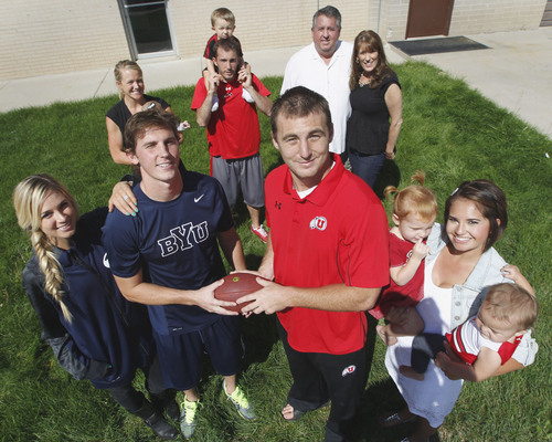 Al Hartmann  |  The Salt Lake Tribune BYU's Drew Reilly and fiancee, Ashlyn, left, and Utah's Trevor Reilly and wife, Jessica, right, surrounded by their parents, Russ and Kris, back-right, and brother AJ with his wife, Bonnie, back-left, at a recent family gathering. Like the brothers, the family's allegiances will be divided when the Utes and Cougars meet in Provo on Saturday.