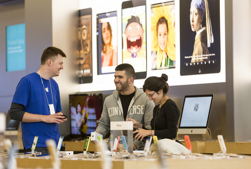 Customers buy the latest versions of the iPhone 5C and 5S at the Apple store at the Americana at Brand mall in Glendale, Calif., Friday, Sept. 20, 2013. Friday is the first time Apple is releasing two different iPhone models at once. (AP Photo/Damian Dovarganes)