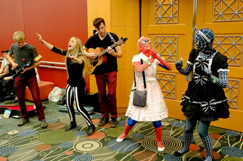 Trent Nelson  |  The Salt Lake Tribune The band Shrink the Giant performs in the hallway at Salt Lake Comic Con in Salt Lake City Saturday, September 7, 2013.