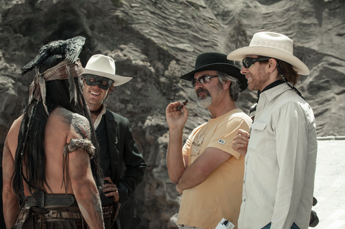 "On the set of ""The Lone Ranger,"" stars Johnny Depp and Armie Hammer (at left) confer with director Gore Verbinski (center) and producer Jerry Bruckheimer. Courtesy Walt Disney Company"