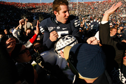 Trent Nelson  |  The Salt Lake Tribune BYU fans hold Brigham Young quarterback Max Hall (15) on their shoulders, celebrating victory as BYU defeats the University of Utah 17-10 in college football action Saturday at BYU's Lavell Edward Stadium in 2007.