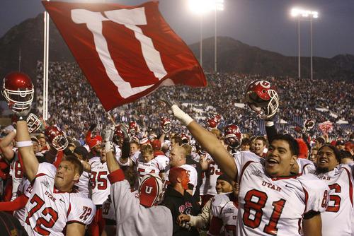 Trent Nelson     The Salt Lake Tribune The Utah football team celebrates victory in Provo. BYU vs. Utah college football Saturday in Provo. 11.19.2005