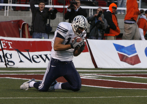 Rick Egan     The Salt Lake Tribune Jonny Harline catches the winning touchdown for BYU , on the last play of the game, in football action BYU vs Utah at Rices-Eccles Stadium.