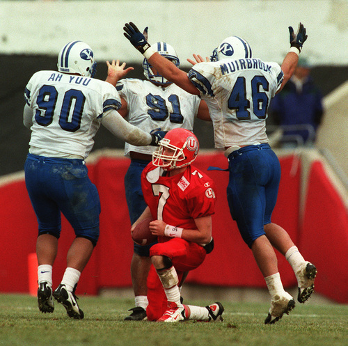 Rick Egan     The Salt Lake Tribune BYU players celebrate a sack of Utah quarterback Mike Fouts in the 1996 BYU - Utah football game.