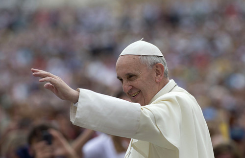 Pope Francis arrives for his weekly general audience in St. Peter's Square, at the Vatican, Wednesday, Sept. 11, 2013. During open-air general audiences the pontiff is driven through the crowd in his car before delivering his message to attendees from the square in front of St. Peter's Basilica. (AP Photo/Alessandra Tarantino)