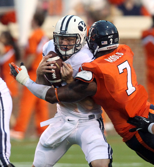 BYU quarterback Taysom Hill (4) is sacked by Virginia defensive end Eli Harold (7) during the first half of an NCAA college football game, Saturday, Aug. 31, 2013, in Charlottesville, Va. Virginia defeated BYU 19-16. (AP Photo/The Daily Progress, Andrew Shurtleff)