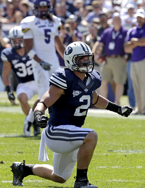"""FILE - In this Sept. 8, 2012, file photo, Brigham Young linebacker Spencer Hadley celebrates after sacking Weber State quarterback Mike Hoke during ab NCAA college football game in Provo, Utah. Hadley has been suspended indefinitely from the football team following a violation of team rules. Hadley will not be eligible to play for the Cougars against rival Utah on Saturday. The senior from Connell, Wash., will sit out at least five games. He can't rejoin the team until the Cougars play Boise State on Oct. 25 at the earliest. School officials did not elaborate on Hadley's actions other than to say it was a """"violation of team rules"""" and BYU's honor code. (AP Photo/Rick Bowmer, File)"""