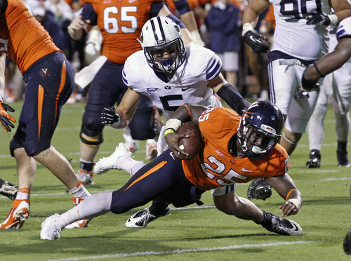 Virginia running back Kevin Parks (25) scores a touchdown in front of Brigham Young linebacker Alani Fua (5) during the fourth quarter of an NCAA college football game, Saturday, Aug. 31, 2013, in Charlottesville, Va. Virginia defeated Brigham Young 19-16. (AP Photo/The Daily Progress, Andrew Shurtleff)