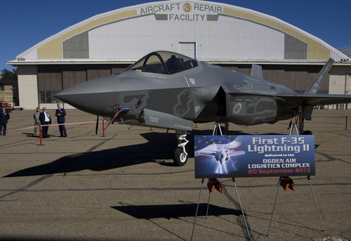 Rick Egan  |  The Salt Lake Tribune Dignitaries and workers at Hill Air Force base get their first look at the the F-35A Joint Strike Fighter on Friday. The F-35A is a multi-variant, multi-role 5th Generation Fighter, and will undergo organic depot modification work at Hill AFB.