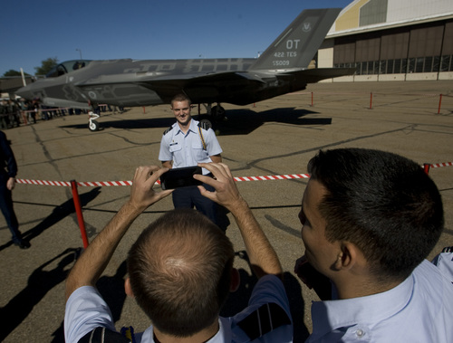 Rick Egan  | The Salt Lake Tribune   Bridger Freeman, Utah State ROTC has his picture taken in front of the F-35 Lightning II, Friday, September 20, 2013. The F-35A is a multi-variant, multi-role 5th Generation Fighter, and will undergo organic depot modification work at Hill AFB.