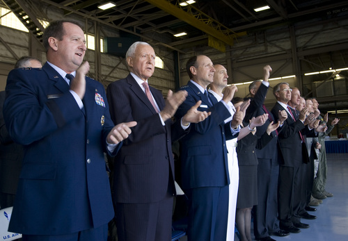 Rick Egan  | The Salt Lake Tribune   Maj. Gen. Brent H. Baker Sr., Ogden Air Logistics Complex commander (left) Sen. Orrin Hatch, Lt. Gen. Bruce Litchfield, Air Force Sustainment Center commander and Rear Adm. Randolph Mahr, DoD F-35 Deputy Program Director; sing along to the Air Force song, at a presentation where dignitaries and workers at Hill Air Force base got their first look at the the F-35A Joint Strike Fighter, Friday, September 20, 2013. The F-35A is a multi-variant, multi-role 5th Generation Fighter, and will undergo organic depot modification work at Hill AFB.