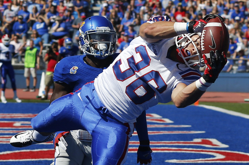 Louisiana Tech running back Hunter Lee (36) makes a touchdown catch as Kansas safety Isaiah Johnson defends during the first half of an NCAA college football game in Lawrence, Kan., Saturday, Sept. 21, 2013. (AP Photo/Orlin Wagner)