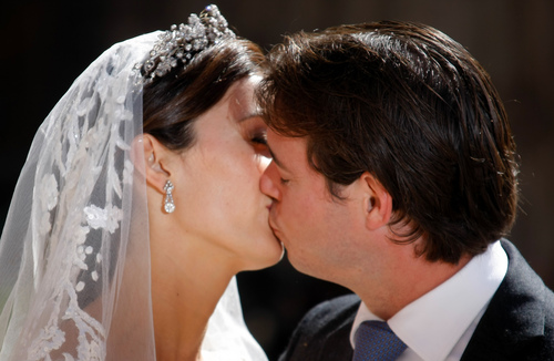 Prince Felix of Luxembourg kisses his wife Claire Lademacher after their church wedding in Saint-Maximin-La-Sainte-Baume, southern France, Saturday, Sept. 21,  2013. (AP Photo/Claude Paris)