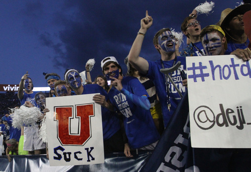 Rick Egan  | The Salt Lake Tribune   BYU fans cheer for the cougars, as BYU faced The University of Utah game, at Lavell Edwards Stadium, Saturday, September 21, 2013.