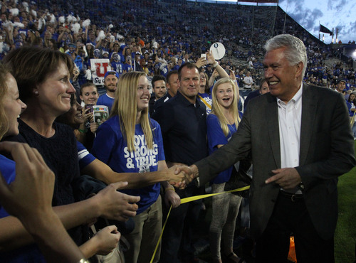 Rick Egan  | The Salt Lake Tribune   Dieter F. Uchtdorf shakes hands with fans  before before BYU faced The University of Utah, at Lavell Edwards Stadium, Saturday, September 21, 2013.