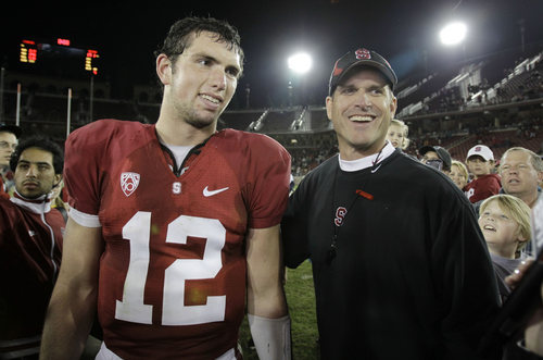 FILE - In this Nov. 6, 2010, file photo, Stanford quarterback Andrew Luck, left, and coach Jim Harbaugh, smile after Stanford defeated Arizona 42-17 in an NCAA college football game in Stanford, Calif.  Luck helped land Harbaugh his first NFL coaching job and Harbaugh played a huge part in the Colts quarterback being selected No. 1 overall in the 2012 NFL draft. Now, these two find themselves in the strange position of game-planning against each other in Week 3, as their teams each try to bounce back from tough losses. (AP Photo/Paul Sakuma)