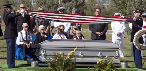 Steve Griffin  |  The Salt Lake Tribune  Kristen Carlson and her sons Jonathan, 6, and Ethan, 3, and family and friends watch as the American Flag, covering the casket of their husband and father, Iraq war veteran James Steven Carlson, is folded graveside at the Utah Veteran's Memorial Park in Bluffdale, Utah Friday, Sept. 20, 2013.