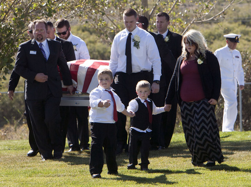 Steve Griffin  |  The Salt Lake Tribune  Kristen Carlson and her sons Jonathan, 6, and Ethan, 3, lead the way as the casket of their husband and father, Iraq war veteran James Steven Carlson, is carried to the graveside at the Utah Veteran's Memorial Park in Bluffdale, Utah Friday, Sept. 20, 2013.