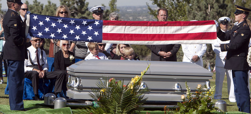 Steve Griffin  |  The Salt Lake Tribune  Kristen Carlson and her sons Jonathan, 6, and Ethan, 3, and family and friends watch as the American Flag covering the casket of their husband and father, Iraq war veteran James Steven Carlson, is folded graveside at the Utah Veteran's Memorial Park in Bluffdale, Utah Friday, Sept. 20, 2013.