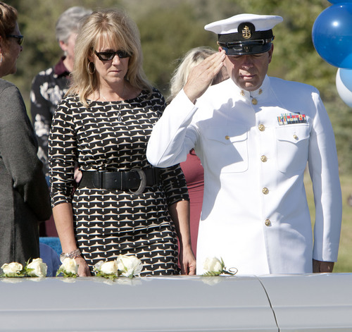 Steve Griffin  |  The Salt Lake Tribune  With his wife, Susie at his side, Naval Reservist, Steve Carlson, salutes the casket of his son, Iraq war veteran James Steven Carlson, during graveside services at the Utah Veteran's Memorial Park in Bluffdale, Utah Friday, Sept. 20, 2013.