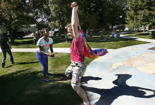 Scott Sommerdorf      The Salt Lake Tribune Sergey Khrushchev dances with Whitney Martin at Provo's first Pride Festival, held at Memorial Park in Provo on Saturday.