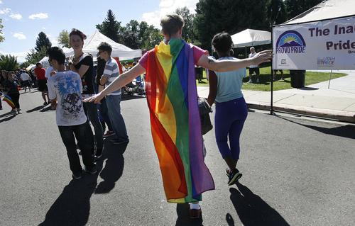 Scott Sommerdorf      The Salt Lake Tribune Sergey Khrushchev, visiting from The Ukraine, walks through Provo's first Pride Festival with friend Whitney Martin at Memorial Park in Provo, Saturday, September 21, 2013.