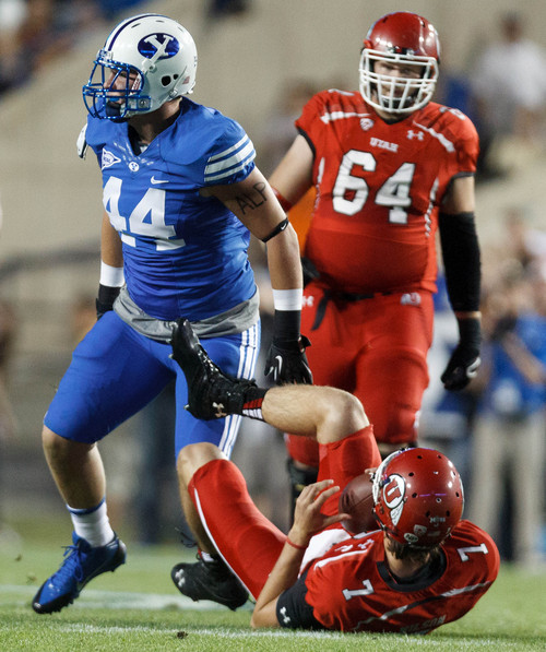 Trent Nelson  |  The Salt Lake Tribune Brigham Young Cougars defensive lineman Remington Peck (44) celebrates sacking Utah Utes quarterback Travis Wilson (7) in the first quarter as the BYU Cougars host the Utah Utes, college football Saturday, September 21, 2013 at LaVell Edwards Stadium in Provo.