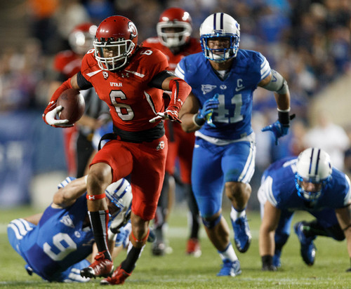 Trent Nelson  |  The Salt Lake Tribune Utah Utes wide receiver Dres Anderson (6) runs out of the hands of Brigham Young Cougars defensive back Daniel Sorensen (9) in the second quarter as the BYU Cougars host the Utah Utes, college football Saturday, September 21, 2013 at LaVell Edwards Stadium in Provo.