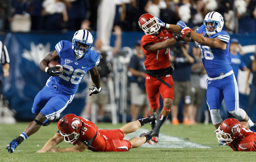 Trent Nelson  |  The Salt Lake Tribune Brigham Young Cougars running back Adam Hine (28) runs for what would have been a touchdown, but was called back on a holding penalty in the first quarter as the BYU Cougars host the Utah Utes, college football Saturday, September 21, 2013 at LaVell Edwards Stadium in Provo.